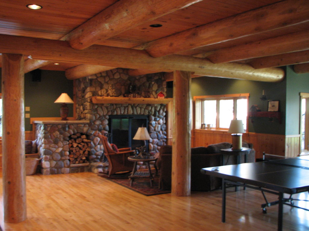 Stone fireplace and log beams