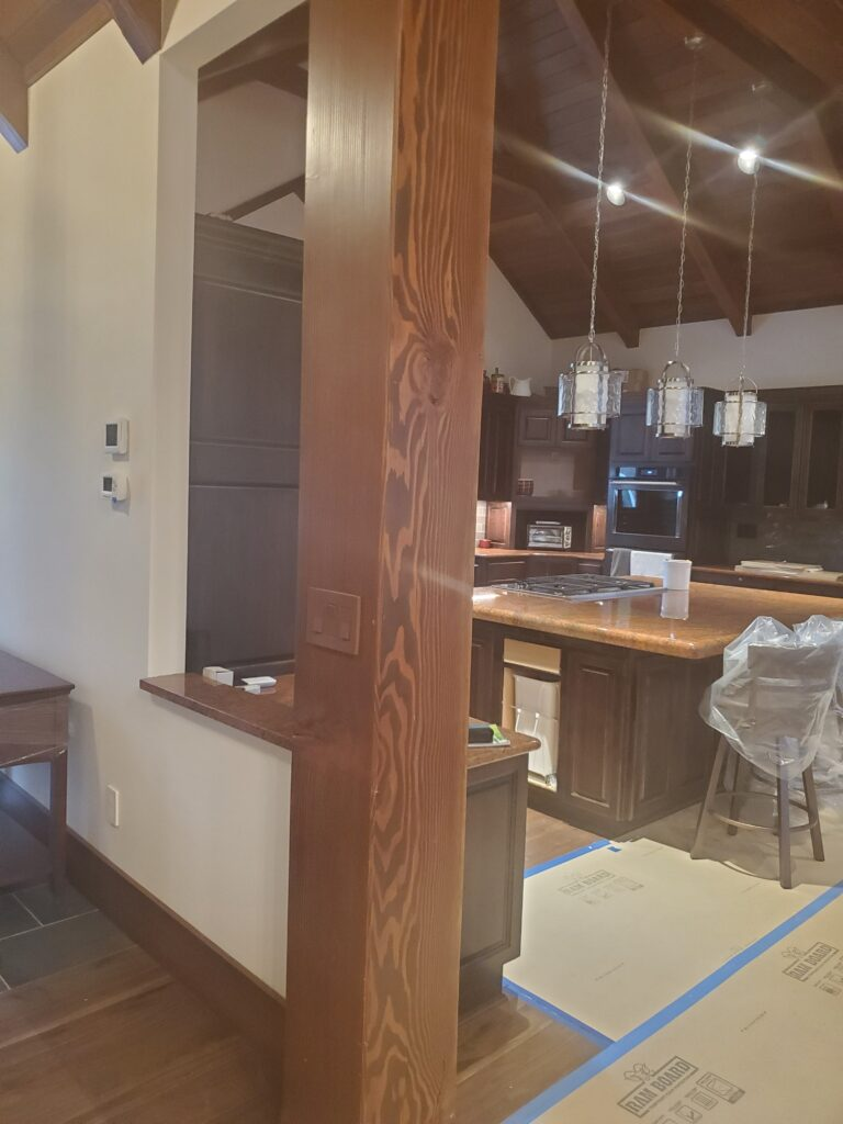 Large timber post entering kitchen area, Custom home by Huisman Concepts