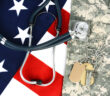 Military fatigues and dog tags on an American Flag with a stethoscope to illustrate health care in the armed services. Horizontal format, fills the frame. (Military fatigues and dog tags on an American Flag with a stethoscope to illustrate health care
