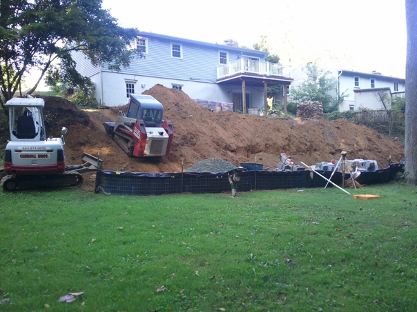 Carroll Bros. Contracting Extending the back yards useful area with a retaining wall - Arnold, MD