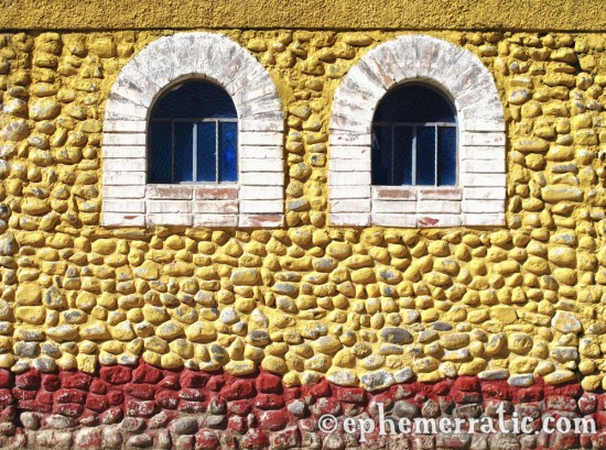 Two windows in a yellow wall, Cabanaconde, Colca Canyon, Peru photo
