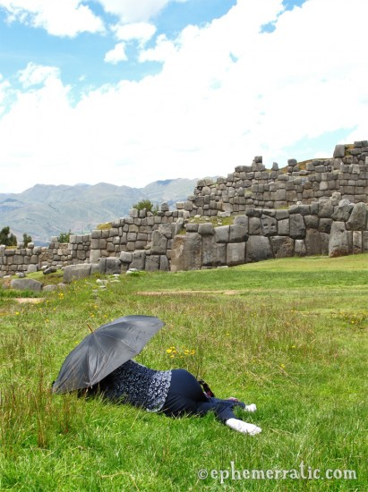 Tour guide naps at Sacsayhuamán, Cusco, Peru photo