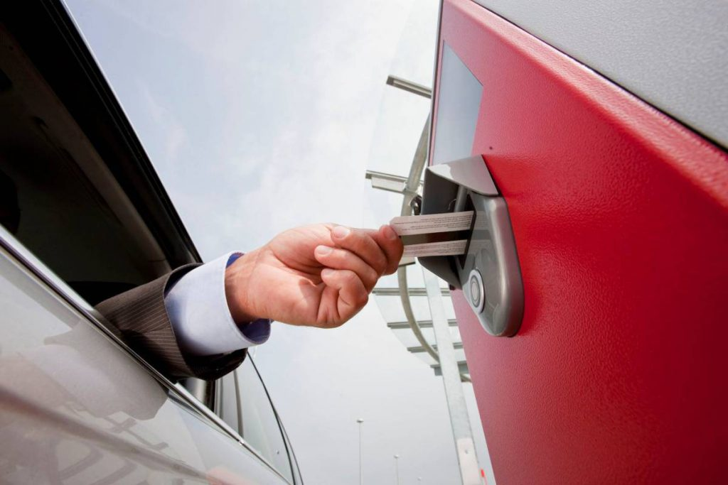 Image of driver Inserting ticket in machine