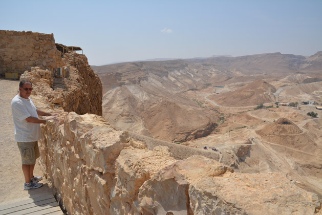 Dan's dad at the top of Masada.  The ramp built by the Romans can be seen in the background in the middle of the photo.