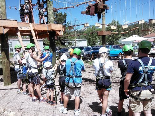 Learning the harnesses and getting ready to climb up!