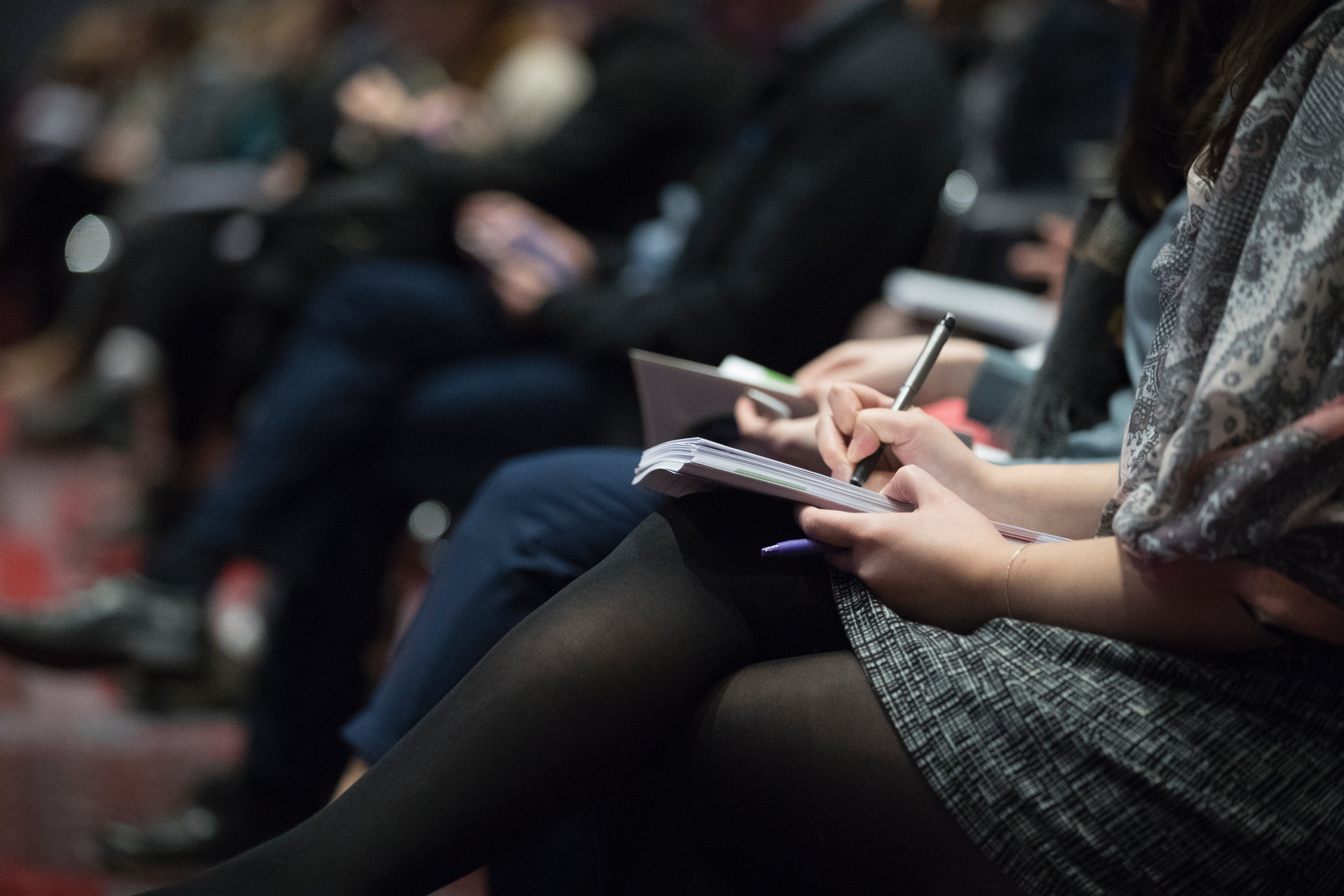People taking notes at a training