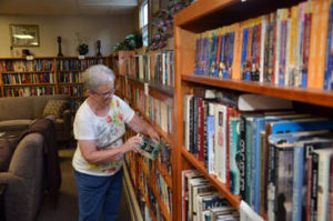 Members enjoy the large library in our Community Center.