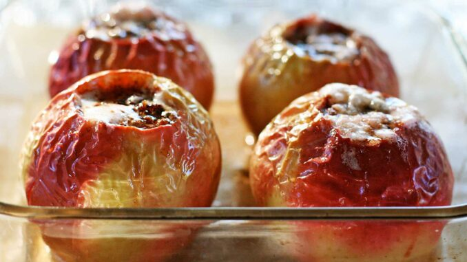 baked apples in a glass pan
