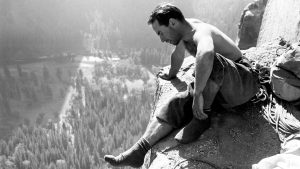 Yosemite climbing pioneer Yvon Chouinard checking out the view from Big Sur ledge the first ascent of the North America Wall on El Capitan. End of pitch 11, Fall 1964. Photo: Tom Frost/Aurora Photos