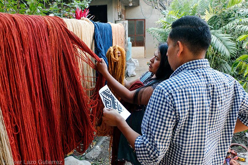 Porfirio and Juana discuss the color choices for a design