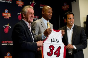 July 11 2012; Miami, FL, USA;  Miami Heat player Ray Allen (34), center, hold up his jersey next to president Pat Riley (left), and head coach Erik Spoelstra (right) during a press conference during a press conference at American Airlines Arena. Mandatory Credit: Steve Mitchell-US PRESSWIRE