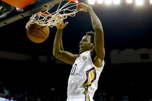 New Orleans Pelicans small forward Al-Farouq Aminu (0) dunks against the Charlotte Bobcats during the first quarter of a game at New Orleans Arena. Mandatory Credit: Derick E. Hingle-USA TODAY Sports