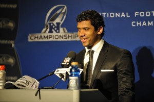 Seattle Seahawks quarterback Russell Wilson (3) addresses the media after the 2013 NFC Championship football game against the San Francisco 49ers at CenturyLink Field. Mandatory Credit: Steven Bisig-USA TODAY Sports
