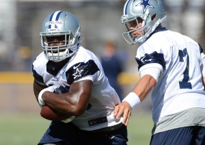 Dallas Cowboys quarterback Caleb Hanie (7) hands off to fullback J.C. Copeland (48) during training camp at the River Ridge Playing Fields. Mandatory Credit: Jayne Kamin-Oncea-USA TODAY Sports