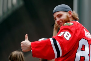 Chicago Blackhawks right wing Patrick Kane (88) gives a thumbs up to the crowd during the 2015 Stanley Cup championship parade and rally at Soldier Field. Mandatory Credit: Jon Durr-USA TODAY Sports