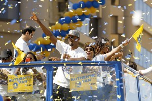 Golden State Warriors forward Harrison Barnes acknowledges the crowd during the Golden State Warriors 2015 championship celebration in downtown Oakland. Mandatory Credit: Cary Edmondson-USA TODAY Sports
