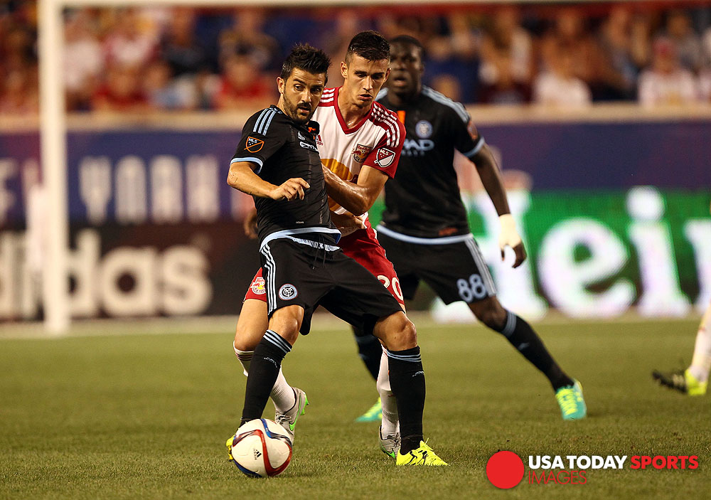 Aug 9, 2015; Harrison, NJ, USA; New York City FC forward David Villa (7) battles for the ball with New York Red Bulls defender Matt Miazga (20) during the second half at Red Bull Arena. Mandatory Credit: Danny Wild-USA TODAY Sports
