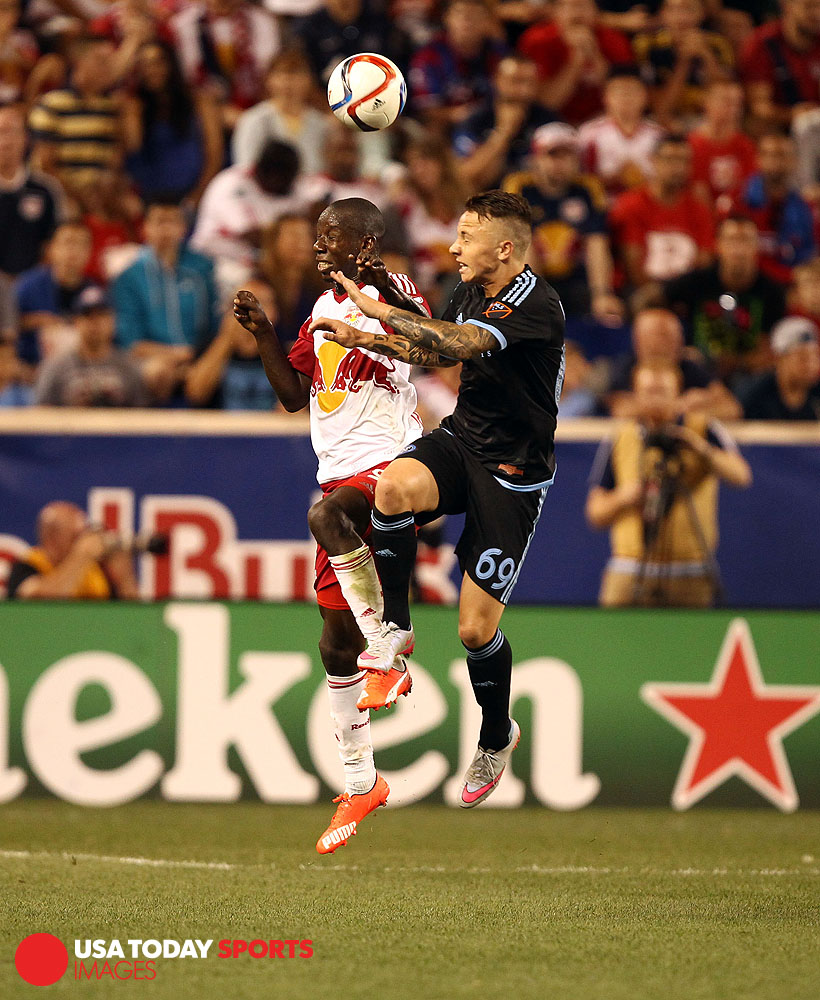 Aug 9, 2015; Harrison, NJ, USA; New York Red Bulls defender Kemar Lawrence (92) and New York City FC defender Angeli?o (69) battle for a ball during the second half at Red Bull Arena. Mandatory Credit: Danny Wild-USA TODAY Sports