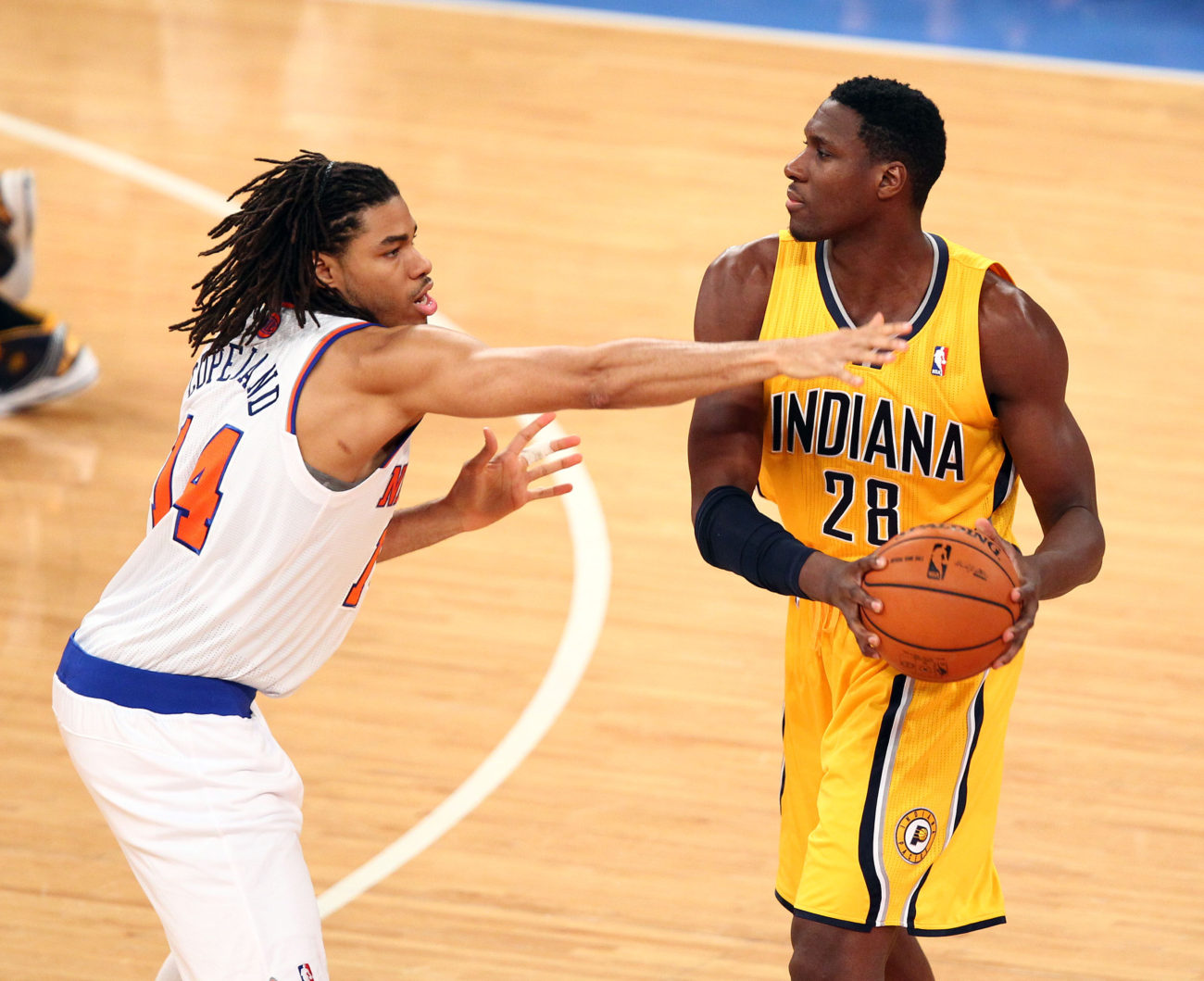 May 5, 2013; New York, NY, USA; Indiana Pacers center Ian Mahinmi (28) is defended by New York Knicks forward Chris Copeland (14) at Madison Square Garden. Mandatory Credit: Danny Wild-USA TODAY Sports