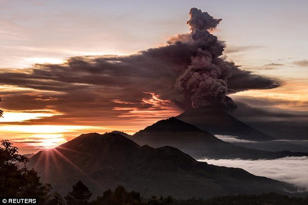 Thousands flee as Bali's volcano Mount Agung spews plumes of ash
