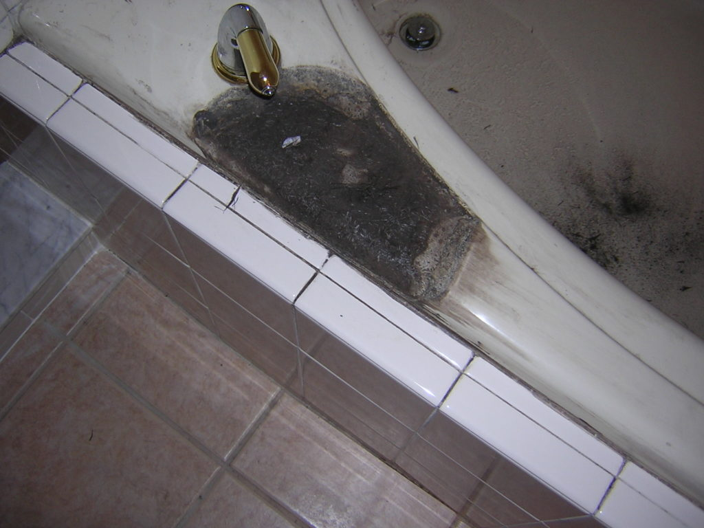 Stained and burnt bathtub BEFORE resurfacing