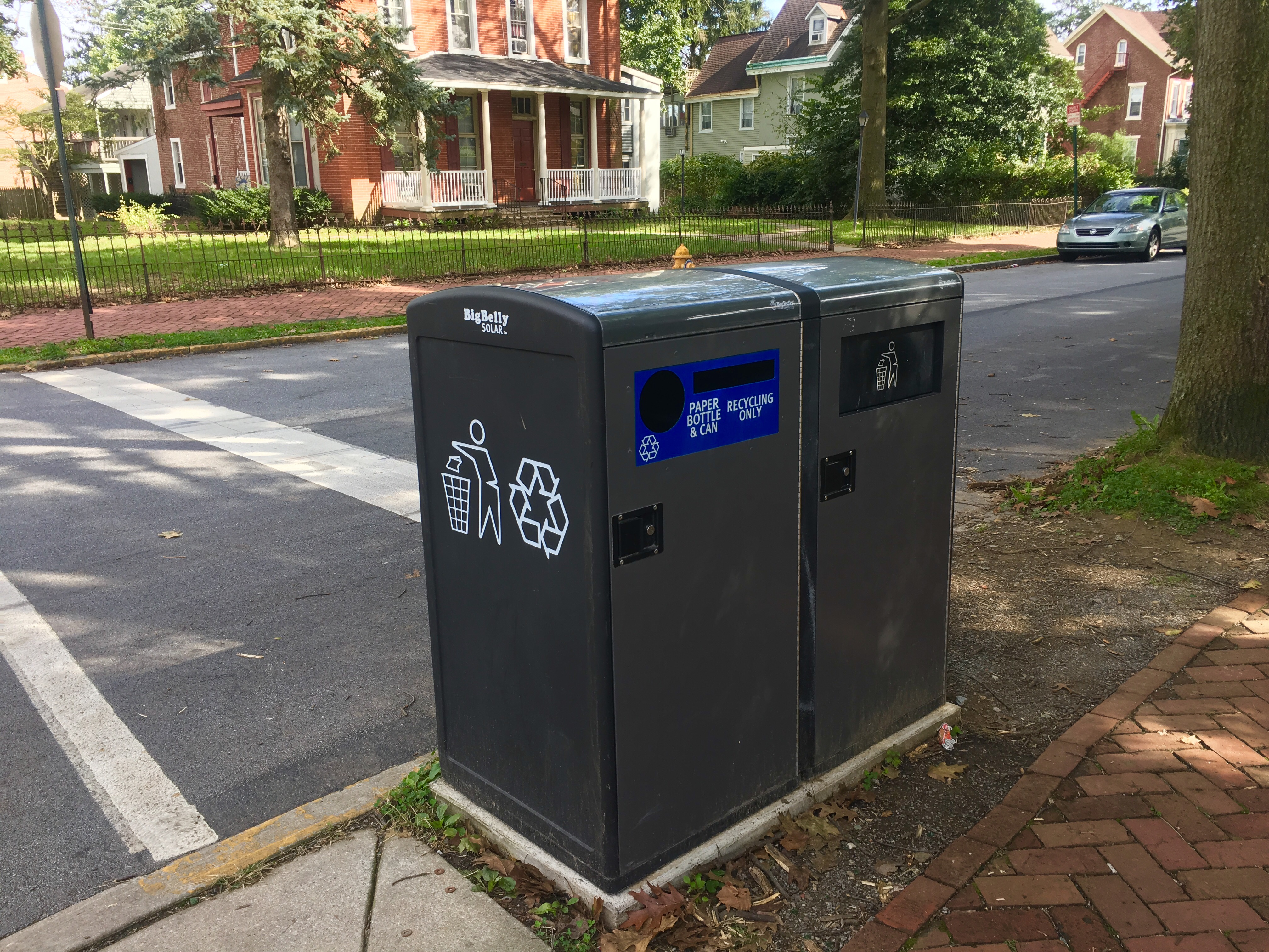 Recycling and Trash containers located off campus on Walnut St