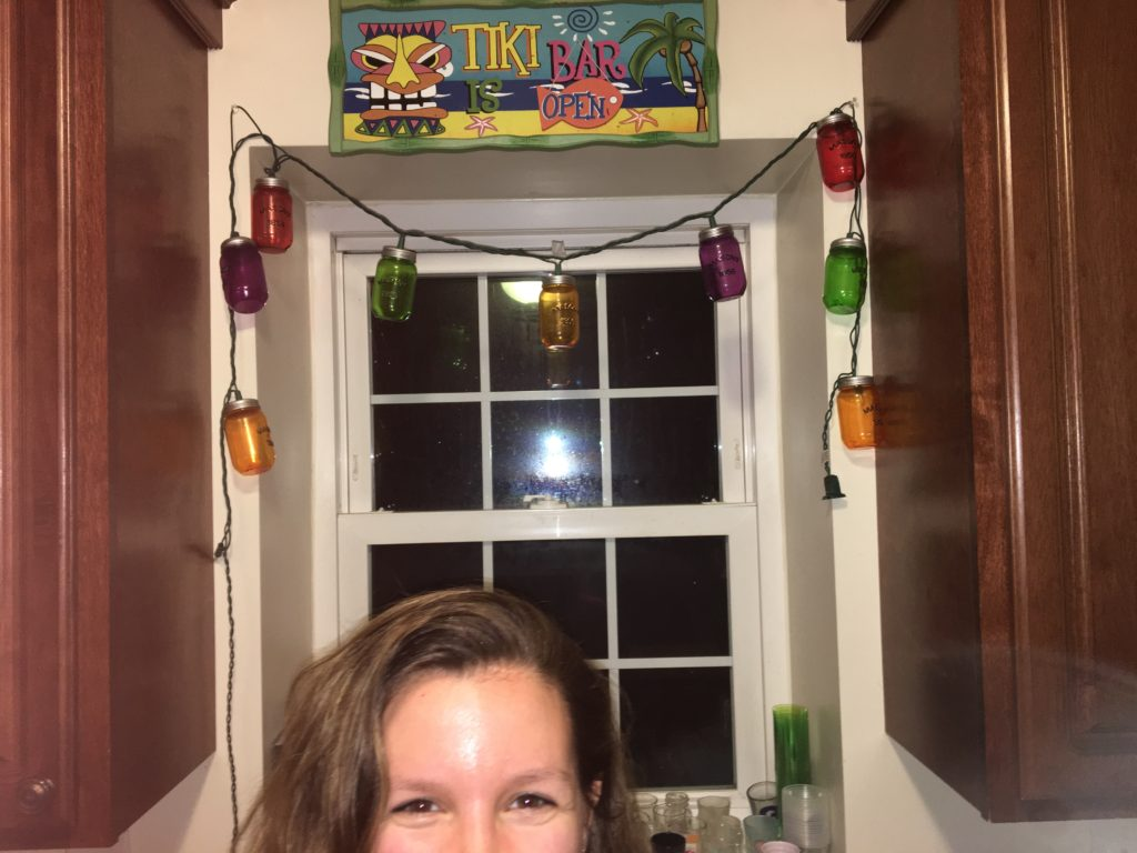 Girl in front of window being spontaneous final year of college