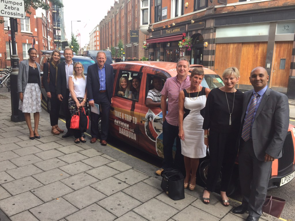 The Antigua and Barbuda Tourism Authority's UK Team and Hotel Partners view the Antigua and Barbuda Branded London Taxis