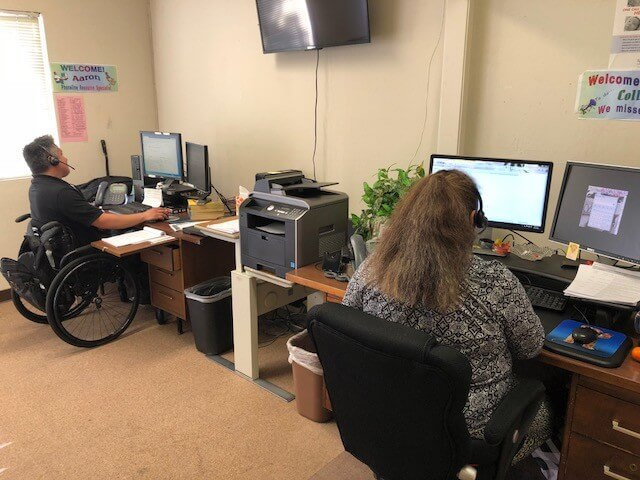 call center with gentleman in a wheelchair