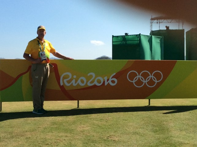 Duane in his Yellow Walking Scorer Olympic Uniform