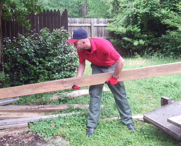 The Junk Squad removing old wood and construction material from an Atlanta residential junk removal job.