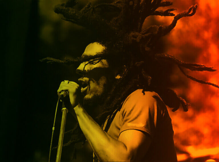 photo of bob marley singing into microphone