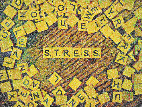 Scrabble stress tiles: Student struggle. focus on mental wellness, financial emergency,