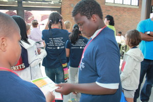 The campers look at the different programs MSUE offers at the market.