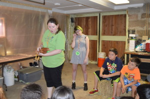 """Ms. Carrie shows off a chicken to the """"chrysalis"""" group"""