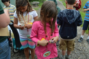 """A """"butterfly"""" explores how to use a compass before they go on their hike in the woods"""