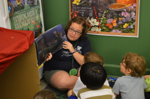 """Ms. Megan reads to the """"eggs"""" while waiting inside for the rain to end"""
