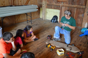 Mr. Alan demonstrates how a hand tool was used before power tools existed