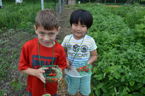 """Two """"eggs"""" show off the strawberries they picked today during Garden Time."""