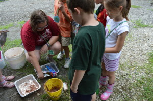 """The """"eggs"""" check out the clay they used for seed balls."""