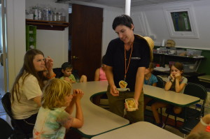 Ms. Mandy shows us crystallized ginger, that helps cure stomach aches