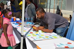 Participant organizations engage with attendees at Bronx Summer Fest 2016.