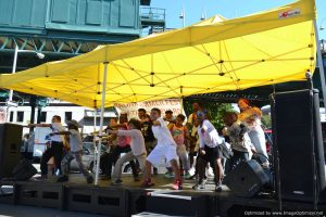 Youngsters and KR3T's dancers delight the crowd onstage at Bronx Summer Fest 2016.