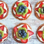 Mini fruit pizzas with strawberry, kiwi, and blueberries littleeatsandthings.com