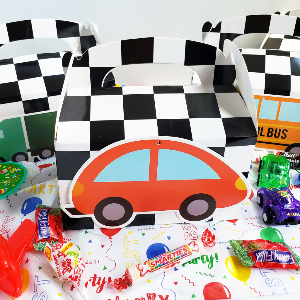 DIY Race Car Party Favor Boxes with black and white checkerboard boxes with cars glued to the front