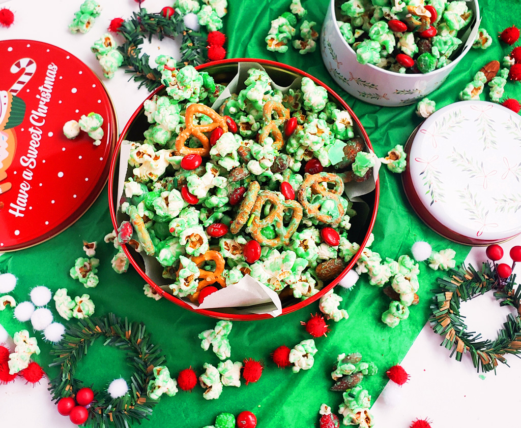 Easy Holiday Grinch Mix made with green white chocolate, almonds, pretzels, and M&Ms