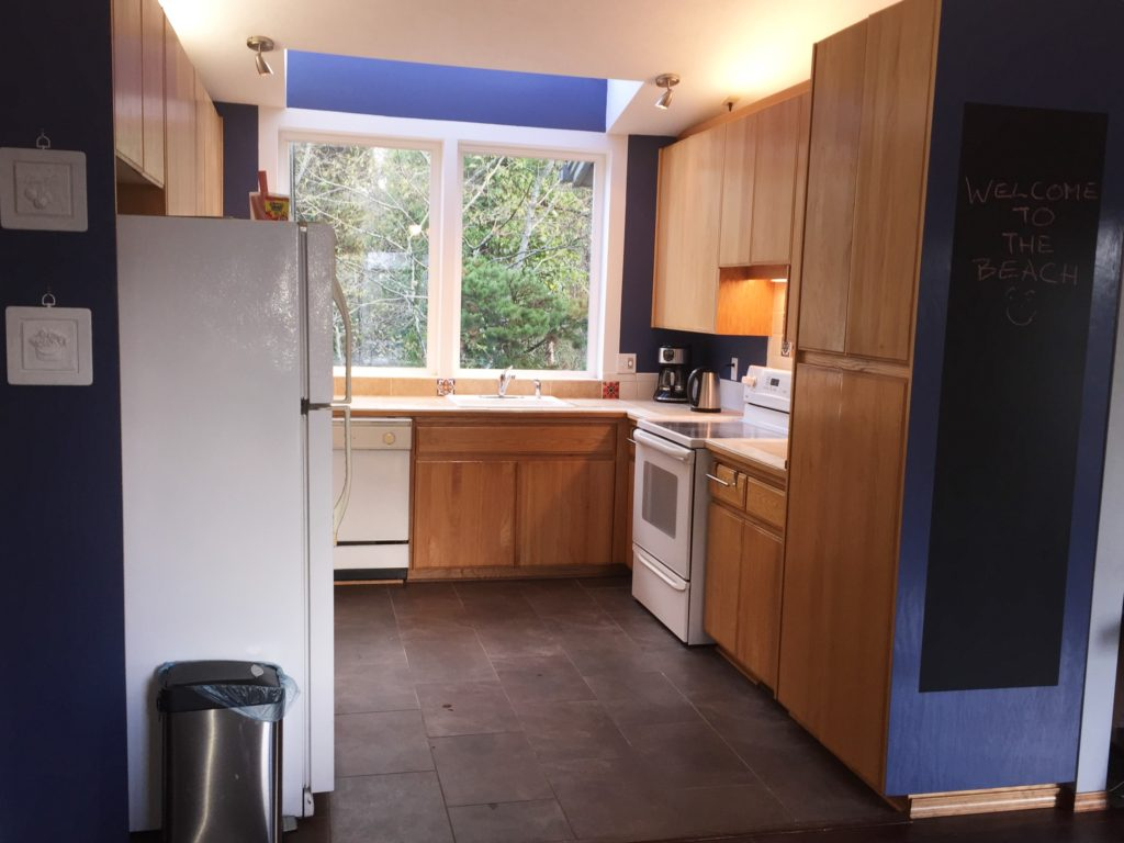 New tile countertops and glass cooktop inspire cooking in this bright kitchen