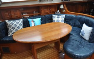 Salon U-Shaped Settee with Table Open