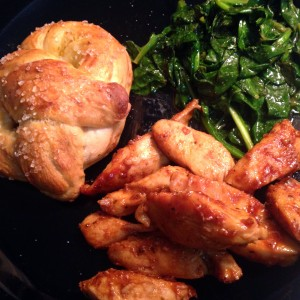 Healthy meal with homemade chicken, pretzel and spinach