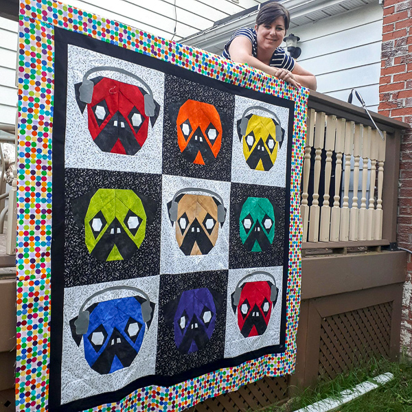 Kate with her Quilt - Who Let the Pugs Out - The Little Bird Designs